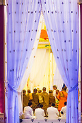 """04 FEBRUARY 2013 - PHNOM PENH, CAMBODIA: NORODOM SIHAMONI, the current King of Cambodia and son of King Father Norodom Sihanouk, and NORODOM MONINEATH SIHANOUK, widow of Cambodian King-Father Norodom Sihanouk, talk to Buddhist monks who presided over Sihanouk's cremation inside the crematorium in Phnom Penh. Norodom Sihanouk (31 October 1922- 15 October 2012) was the King of Cambodia from 1941 to 1955 and again from 1993 to 2004. He was the effective ruler of Cambodia from 1953 to 1970. After his second abdication in 2004, he was given the honorific of """"The King-Father of Cambodia."""" Sihanouk died in Beijing, China, where he was receiving medical care, on Oct. 15, 2012.    PHOTO BY JACK KURTZ"""