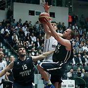 Anadolu Efes's Dusko Savanovic (R) and Estaban Batista (2ndL) during their Turkish Basketball league derby match Besiktas between Anadolu Efes at the BJK Akatlar Arena in Istanbul Turkey on Saturday 31 December 2011. Photo by TURKPIX