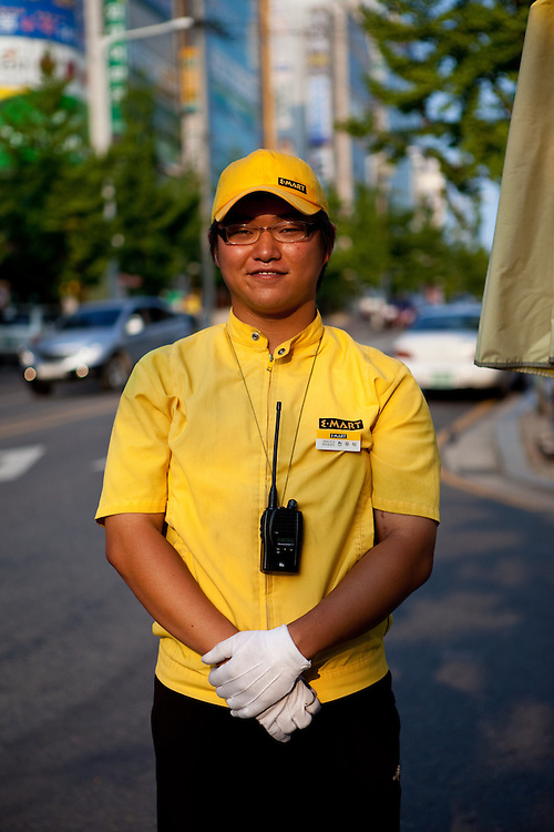 Portrait of a young man working for a big shopping mall in the city of Daegu. South Korea, Republic of Korea, KOR, 06 September 2009.