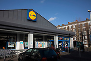 Supermarket chain Lidl store on Old Kent Road on 9th January 2020 in London, England, United Kingdom. Lidl Stiftung & Co. KG is a German global discount supermarket chain, that operates over 10,000 stores across Europe and the US. It belongs to Dieter Schwarz, who also owns the store chains Handelshof and hypermarket Kaufland. With its low price, discount approach, Lidl is rapidly becomming serious competition to the big four supermarkets in the UK.
