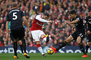 Sead Kolasinac of Arsenal (c) takes a shot at goal. Premier league match, Arsenal v Swansea city at the Emirates Stadium in London on Saturday 28th October 2017.<br /> pic by Steffan Bowen, Andrew Orchard sports photography.