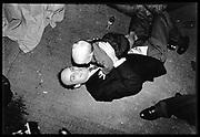 Nicholas Coleridge on floor at wedding. 1991. © Copyright Photograph by Dafydd Jones 66 Stockwell Park Rd. London SW9 0DA Tel 020 7733 0108 www.dafjones.com