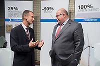 23 OCT 2012, BERLIN/GERMANY:<br /> Dr.-Ing. Herbert Diess (L), Mitglied des Vorstandsmitglied Entwicklung der BMW AG, begruesst Peter Altmaier (R), CDU, Bundesumweltminister, BMW Leistungsschau Elektromobilitaet, E-Werk Berlin<br /> IMAGE: 20121023-02-099<br /> KEYWORDS: Automobilindustrie, KFZ, Auto, Elektromobilität, E-Mobility