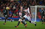 Kurt Zouma of Stoke City ® challenges Kevin De Bruyne of Manchester City. Premier league match, Stoke City v Manchester City at the Bet365 Stadium in Stoke on Trent, Staffs on Monday 12th March 2018.<br /> pic by Andrew Orchard, Andrew Orchard sports photography.<br /> c