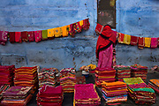 Colourful saris for sale in the market on 21st February 2018 in Jodhpur, Rajasthan, India. Popularly known as the Blue City, Jodhpur is a city in the Thar Desert of the northwest Indian state of Rajasthan. Jodhpur is the Handicraft Hub of India.