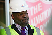 Emmitt Smith, advisory council chair of the North Texas Youth Education Town, leads the media on a tour of the Salvation Army renovation project in Arlington on Thursday, March 14, 2013. (Cooper Neill/The Dallas Morning News)