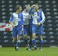 Photo. Aidan Ellis.Digitalsport<br /> Blackburn Rovers v Bournemouth.<br /> Carling Cup 2nd round.<br /> 22/09/2004.<br /> Blackburn's Paul Gallagher celebrates his goal and teams third with team mates Brett Emerton and Morten Gamst Pedersen