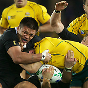 Keven Mealamu, New Zealand (left) and Richie McCaw, New Zealand, make a tackle during the New Zealand V Australia Semi Final match at the IRB Rugby World Cup tournament, Eden Park, Auckland, New Zealand, 16th October 2011. Photo Tim Clayton...