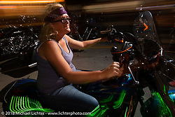 Riding Main Street at night during the 78th annual Sturgis Motorcycle Rally. Sturgis, SD. USA. Saturday August 11, 2018. Photography ©2018 Michael Lichter.