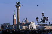 "View from the Piazzetta with streetamps and column with St Mark's lion and the statue of Saint Teodoro of Amasea, ""Santodaro"" to the Venetians, who is standing on the sacred crocodile of Egypt. In the distance, facing St. Mark Basin is the San Giorgio Maggiore basilica, designed by Andrea Palladio and located on the island of San Giorgio Maggiore, Venice, Italy...Subject photograph(s) are copyright Edward McCain. All rights are reserved except those specifically granted by Edward McCain in writing prior to publication...McCain Photography.211 S 4th Avenue.Tucson, AZ 85701-2103.(520) 623-1998.mobile: (520) 990-0999.fax: (520) 623-1190.http://www.mccainphoto.com.edward@mccainphoto.com."