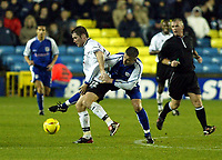 Photo. Chris Ratcliffe<br />Millwall v Derby County. FA Nationwide 1st Division. 22/11/2003<br />Andy Roberts of Millwall tries to get to grips with Lee Bradbury of Derby