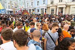 London, August 28 2017. The tightly packed crowd on Ladbroke Grove on Day Two of the Notting Hill Carnival, Europe's biggest street party held over two days of the August bank holiday weekend, attracting over a million people. © Paul Davey.