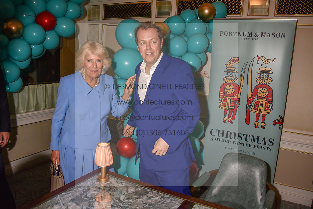 HRH The Duchess of Cornwall and Tom Parker Bowles at the launch of the Fortnum & Mason Christmas & Other Winter Feasts Cook Book by Tom Parker Bowles held at Fortnum & Mason, 181 Piccadilly, London, England. 17 October 2018.