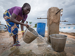 30 May 2019, Mokolo, Cameroon: A woman cleans one of the water points in the transit zone to Minawao camp for Nigerian refugees. Before being settled in the camp, newly arriving refugees are hosted in the transit zone until their arrival has been registered by UNHCR. The Minawao camp for Nigerian refugees, located in the Far North region of Cameroon, hosts some 58,000 refugees from North East Nigeria. The refugees are supported by the Lutheran World Federation, together with a range of partners.