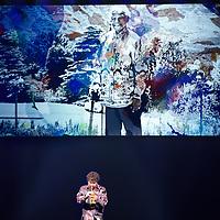 Nederland, Amsterdam , 15 december 2013.<br /> Herdenking Mandela.<br /> Prinses Beatrix is rond het middaguur aangekomen bij de Stadsschouwburg in Amsterdam. Zij woont daar het Nationaal Eerbetoon Samen door Mandela bij. Burgemeester Eberhard van der Laan van Amsterdam ontving de prinses op de rode loper voor de schouwburg.<br /> Voorafgaand aan het programma heeft Beatrix een ontmoeting met de initiatiefnemers van het eerbetoon, onder wie Conny Braam (oud-voorzitter Anti Apartheidsbeweging Nederland), Melle Daamen (directeur Stadsschouwburg) en zangeres en actrice Gerda Havertong. Namens het kabinet is minister Jet Bussemaker van Onderwijs, Cultuur en Wetenschap aanwezig.De aankomst van de prinses werd begeleid door een Afrikaanse drumband. Tientallen belangstellenden stonden langs de loper en voor de schouwburg mee te klappen, dansen en sommigen zongen 'Mandela! Mandela!'.<br /> Op de foto jazz trompettist Eric Vloeimans in de Stadsschouwburg speelt bij een bewerkte foto van fotograaf Anton Corbijn door kunstenares Marlene Dumas tijdens herdenking overleden Mandela.<br /> Foto:Jean-Pierre Jans