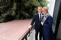French President Emmanuel Macron and his wife Brigitte Macron pose on the balcony of the room at the Hotel de la Poste where aviator Jean Mermoz stayed in Saint-Louis, Senegal, on February 3, 2018. Photo by Philippe Wojazer / Pool / ABACAPRESS.COM