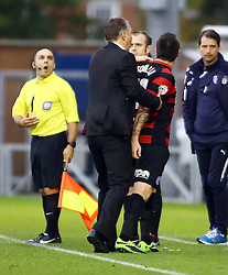 Peterborough United's Lee Tomlin confronts linesman Mr M Buonassisi after being sent off for an off the ball incident - Photo mandatory by-line: Joe Dent/JMP - Tel: Mobile: 07966 386802 26/10/2013 - SPORT - FOOTBALL - Colchester Community Stadium - Colchester - Colchester United v Peterborough United - Sky Bet League One