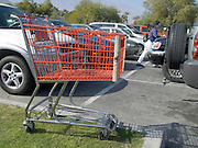 a supermarket cart safely parked between cars