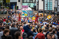 © Licensed to London News Pictures . 17/06/2018. Manchester , UK . A fake news float featuring images of Boris Johnson , Donald Trump and Theresa May . The 2018 Manchester Day parade , celebrating Manchester's cultural and social life and diversity, passes through Manchester City Centre . Photo credit : Joel Goodman/LNP