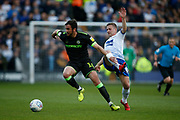 Forest Green Rovers Gavin Gunning(16) and Jay Harris of Tranmere Rovers contest a loose ball  during the EFL Sky Bet League 2 play off first leg match between Tranmere Rovers and Forest Green Rovers at Prenton Park, Birkenhead, England on 10 May 2019.