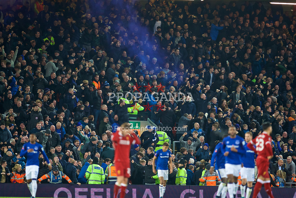 LIVERPOOL, ENGLAND - Friday, January 5, 2018: Everton supporter celebrate with a blue smoke bomb after scoring an equalising goal to level the score 1-1 during the FA Cup 3rd Round match between Liverpool FC and Everton FC, the 230th Merseyside Derby, at Anfield. (Pic by David Rawcliffe/Propaganda)