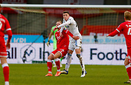 Leeds United defender Oliver Casey (49) wins the header  during the The FA Cup match between Crawley Town and Leeds United at The People's Pension Stadium, Crawley, England on 10 January 2021.