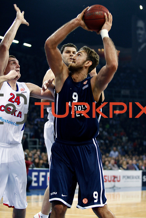 Anadolu Efes's Semih Erden (R) and CSKA Moscow's Alexandr Kaun (L) during their Euroleague Top 16 game 8 basketball match Anadolu Efes between CSKA Moscow at the Abdi Ipekci Arena in Istanbul at Turkey on Friday, February, 22, 2013. Photo by TURKPIX