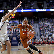 UNCASVILLE, CONNECTICUT- DECEMBER 4:  Brianna Taylor #20 of the Texas Longhorns drives to the basket while defended by Kia Nurse #11 of the Connecticut Huskies during the UConn Huskies Vs Texas Longhorns, NCAA Women's Basketball game in the Jimmy V Classic on December 4th, 2016 at the Mohegan Sun Arena, Uncasville, Connecticut. (Photo by Tim Clayton/Corbis via Getty Images)