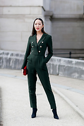 Street style, Chriselle Lim arriving at Elie Saab Fall-Winter 2018-2019 show held at le Grand Palais, in Paris, France, on March 3rd, 2018. Photo by Marie-Paola Bertrand-Hillion/ABACAPRESS.COM