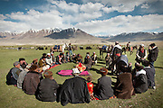 Kyrgyz men coming from surrounding camps, gather at Bibi Zohra's wedding. Following a Kyrgyz tradition, the future husband is given clothes that were sewn by his future wife...Trekking through the high altitude plateau of the Little Pamir mountains (average 4200 meters) , where the Afghan Kyrgyz community live all year, on the borders of China, Tajikistan and Pakistan.