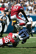 Los Angeles Rams wide receiver Robert Woods (17) gets tackled by Arizona Cardinals defensive back Budda Baker (36) as Arizona Cardinals linebacker Gerald Hodges (51) leaps over the pile as Woods catches a second quarter pass for a gain of 9 yards to the Cardinals 13 yard line during the 2018 NFL regular season week 2 football game against the Arizona Cardinals on Sunday, Sept. 16, 2018 in Los Angeles. The Rams won the game in a 34-0 shutout. (©Paul Anthony Spinelli)