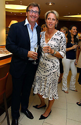 JOHN & ANOUSKA AYTON of Links of London at a party hosted by Links at their store in Sloane Square, London to celebrate the forthcoming Glorious Goodwood Racing festival held on 26th July 2006.<br />