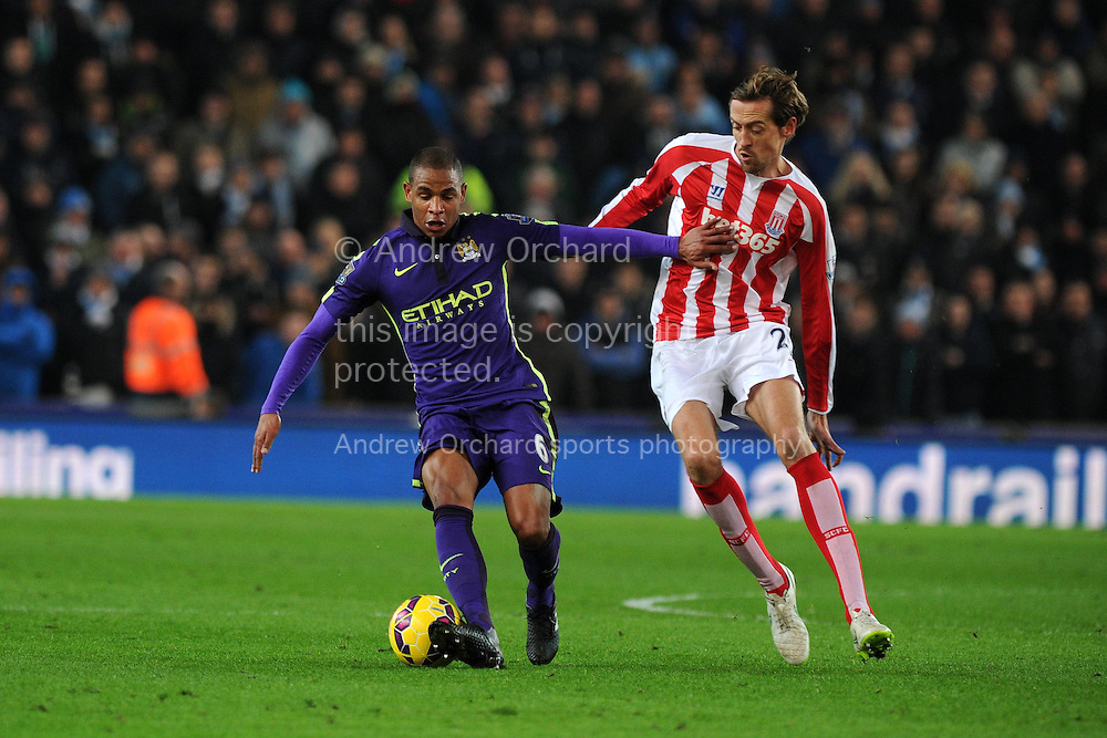Fernando of Manchester city holds off Peter Crouch of Stoke city. Barclays Premier League match, Stoke city v Manchester city at the Britannia Stadium in Stoke on Trent , Staffs on Wed 11th Feb 2015.<br /> pic by Andrew Orchard, Andrew Orchard sports photography.