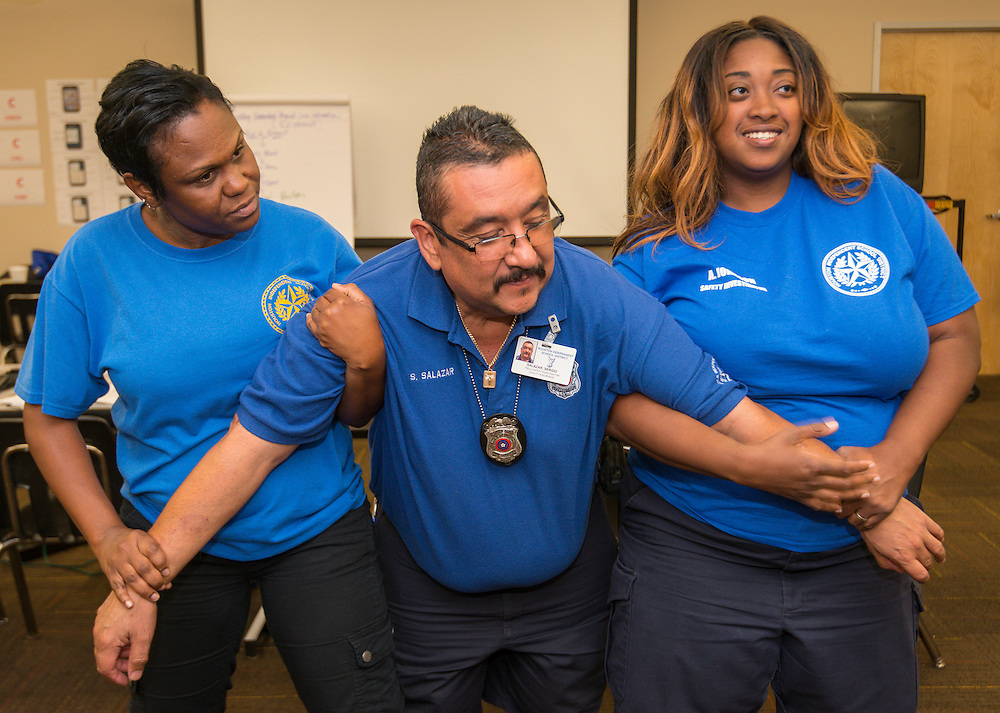Transportation employees are taught non-lethal physical crisis intervention techniques by Crisis Prevention Institute instructor Tom Harvey, June 19, 2014.