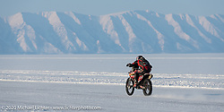 An Husqvarna on the mile long track at the Baikal Mile Ice Speed Festival. Maksimiha, Siberia, Russia. Friday, February 28, 2020. Photography ©2020 Michael Lichter.