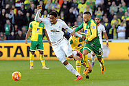 Swansea City's Leroy Fer (r) is fouled by Norwich's Nathan Redmond (r) and Gay O'Neil (background). Barclays Premier league match, Swansea city v Norwich city at the Liberty Stadium in Swansea, South Wales on Saturday 5th March 2016.<br /> pic by  Carl Robertson, Andrew Orchard sports photography.