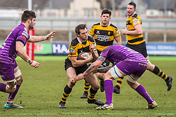 Newport's Elliot Frewen is tackled by Ebbw Vale's Rhys Clarke - Mandatory by-line: Craig Thomas/Replay images - 04/02/2018 - RUGBY - Rodney Parade - Newport, Wales - Newport v Ebbw Vale - Principality Premiership