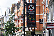 20 MPH speed limit sign on Marylebone High Street on 10th August 2021 in London, United Kingdom. Marylebone High Street is a grand and upmarket shopping street in London.