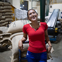 Selenia Pineda, 26, from San Pedro Sula, works in the coffee warehouse at Molinos.