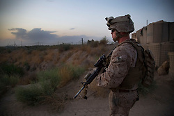 August 22, 2017 - (FILE PHOTO) - US President Donald Trump has announced he would prolong the US military intervention in Afghanistan. PICTURED: May 4, 2014 - Sangin, Helmand, Afghanistan - A Marine prepares to leave the wire to escort several to the landing zone just outside Forward Operating Base Yakhchao. Hand-off in northern Helmand comes as NATO combat mission wanes. The last U.S. Marines withdrew from northern Helmand early Monday morning, turning their two remaining bases in the hard-fought Sangin district over to Afghan national security forces. (Credit Image: © Nelvin C. Cepeda/U-T San Diego/ZUMAPRESS.com)