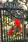 Christmas wreath on an iron gate of a historic home in Charleston, South Carolina.
