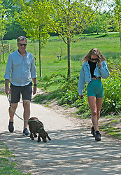 ©Licensed to London News Pictures 07/05/2020  <br /> Tunbridge Wells, UK. Walking the dog. People out and about enjoying the sunny hot weather in Dunorlan Park, Tunbridge Wells, Kent. Photo credit:Grant Falvey/LNP