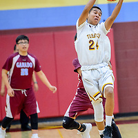 Tohatchi Cougar Brandon Lucero (24) catches a high pass while playing the Ganado Hornets during the Rehoboth Invitational basketball tournament at Rehoboth High School Friday.