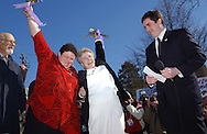 NEW PALTZ, NY.  JoAnne Still (left) and her partner Mary Mendola (right), both of Accord, NY rejoicing together after their wedding ceremony performed by Mayor Jason West (far right) in New Paltz, NY on Friday, February 27, 2004. Mayor West officiated over the first same-sex weddings in the country.  © Chet Gordon for the NY Daily News