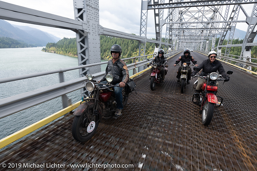 Doug Feinsod on his Indian beside land-speed record holder Jody Perewitz with Dan and Todd Kraft behind as they cross a bridge into Oregon on the last day of the Motorcycle Cannonball coast to coast vintage run. Stage 15  (51 miles - the Grand Finish) from The Dalles to Stevenson, OR. Sunday September 23, 2018. Photography ©2018 Michael Lichter.