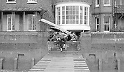 Chiswick. London.<br /> Eights starting from Mortlake<br /> Crew, carring the boat out of the boathouse. ARA Headquarters W6.<br /> 1987 Head of the River Race over the reversed Championship Course Mortlake to Putney on the River Thames. Saturday 28.03.1987. <br /> <br /> [Mandatory Credit: Peter SPURRIER;Intersport images] 1987 Head of the River Race, London. UK