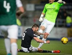 Hibernian's keeper Mark Oxley tackles Falkirk's Lee Miller. Falkirk 0 v 1 Hibernian, Scottish Championship game played 20/10/2015 at The Falkirk Stadium.