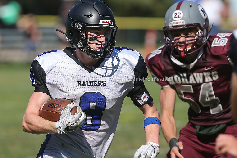 (9/28/19, MILLIS, MA) Dover-Sherborn's Luke Fielding  runs the ball during the Tri-Valley League game against Millis at Millis High School on Saturday. [Daily News and Wicked Local Photo/Dan Holmes]