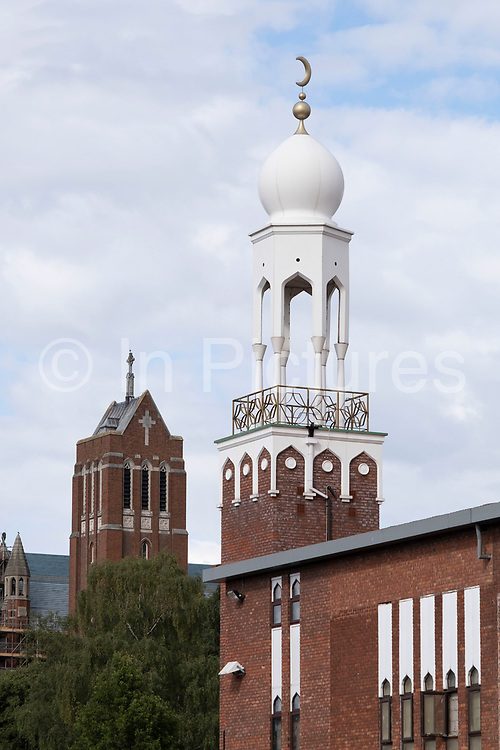 Birmingham Central Mosque stands before St Alban the Martyr, Birmingham, a Grade II listed Church of England parish church in Highgate, on 3rd August 2020 in Birmingham, United Kingdom. Birmingham Central Mosque is one of the earliest purpose-built mosques in the UK, and is run by the Birmingham Mosque Trust. The organization, Muslims in Britain classify the Birmingham Central Mosque as, hanafi sunni, and has a capacity of 6,000, including women.