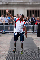 © Licensed to London News Pictures. 10/09/2012. LONDON, UK. Former soldier Derek Derenalagi, a Paralympic athlete, arrives at a reception for British Olympic and Paralymic athletes held at the Queen Elizabeth II Conference Centre in London today (10/09/12). Derek lost his legs to a bomb in Afghanistan in 2007. Photo credit: Matt Cetti-Roberts/LNP